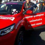 Un sapeur-pompier ardéchois fait partie de la caravane publicitaire du Tour de France aux couleurs des sapeurs-pompiers de France